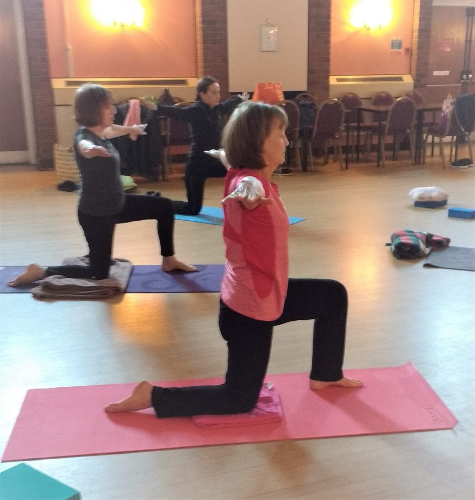 ladies kneeling doing yoga